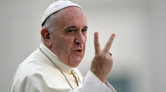 Pope Francis gestures aboard his Popemobile as he arrives for an audience with participants of an international pilgrimage of altar servers on August 4, 2015 in Saint Peter's Square at the Vatican.   AFP PHOTO / FILIPPO MONTEFORTE        (Photo credit should read FILIPPO MONTEFORTE/AFP/Getty Images)