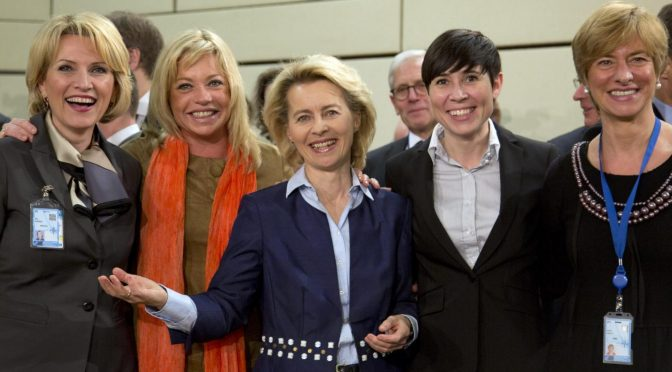 From left, defense ministers, Albania's Mimi Kodheli, Netherland's Jeanine Hennis-Plasschaert, Germany's Ursula von der Leyen, Norway's Ine Marie Eriksen Soreide and Italy's Roberta Pinotti pose for photographers prior to the start of a meeting of defense ministers of the North Atlantic Council at NATO headquarters in Brussels on Wednesday, Feb. 26, 2014. Frustrated with his Afghan counterpart, U.S. President Barack Obama is ordering the Pentagon to accelerate planning for a full U.S. troop withdrawal from Afghanistan by the end of this year. But Obama is also holding out hope that Afghanistan's next president may eventually sign a stalled security agreement that could prevent the U.S. from having to take that step. (AP Photo/Virginia Mayo)